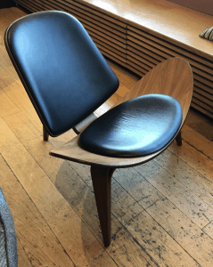 Shell shaped chair in wood with blue seat